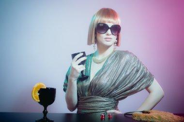 Woman in Sunglasses at Bar