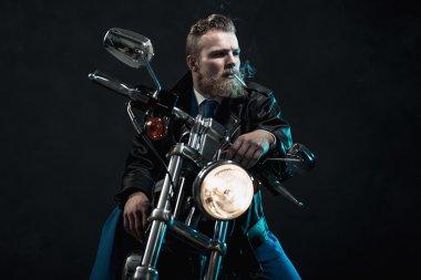 Macho businessman riding his motorbike