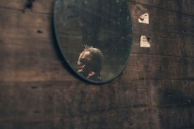 Reflection of elderly man in mirror