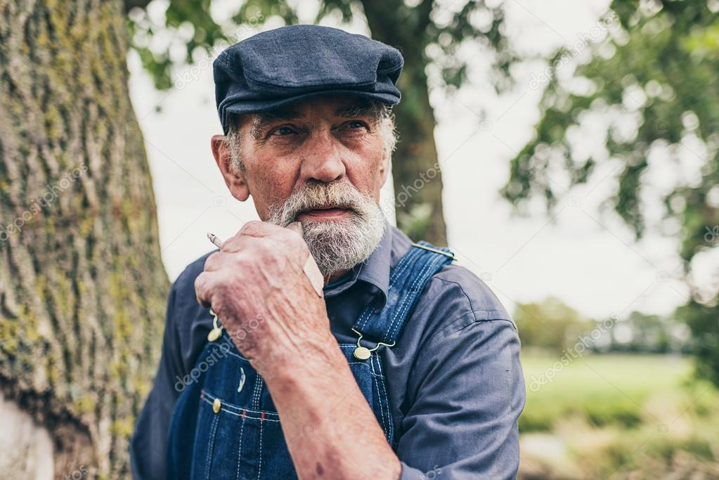 Senior country farmer smoking