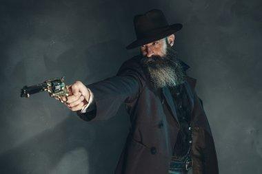 Gun shooting vintage crook