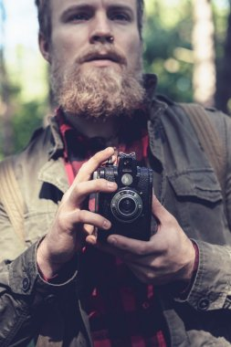 Man with beard in forest