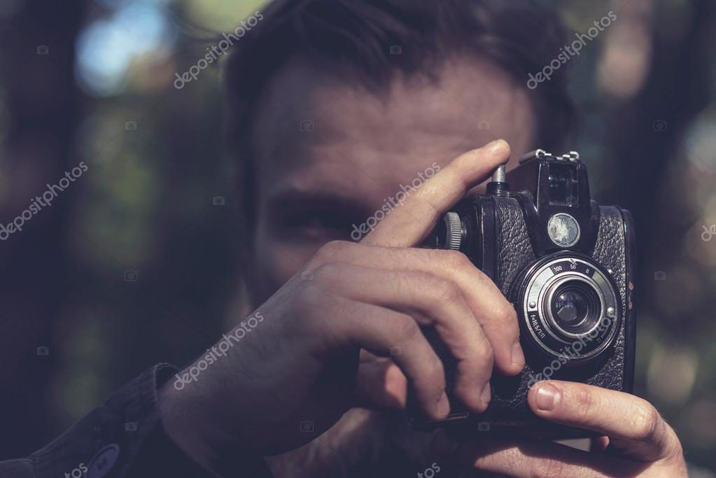 Close-up of hands holding vintage camera
