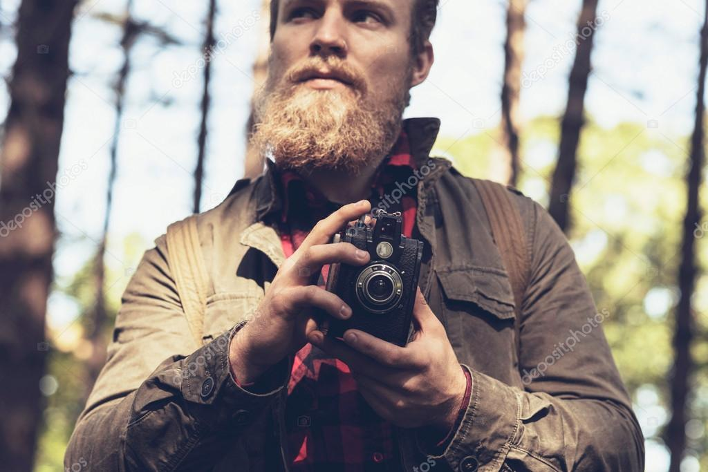 beard with vintage camera