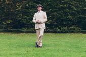 Fotografie Dandy standing on lawn