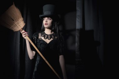 Dark mysterious witch fashion woman.