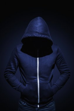 Low key image of a man in hoodie shirt