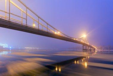 Footbridge in winter Kiev at night stock vector