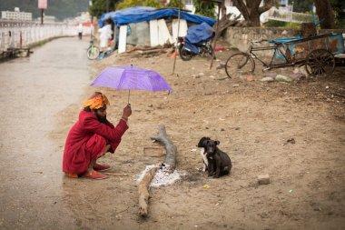 RISHIKESH, INDIA - JAN 02: An unidentified sadhu baba get wormin