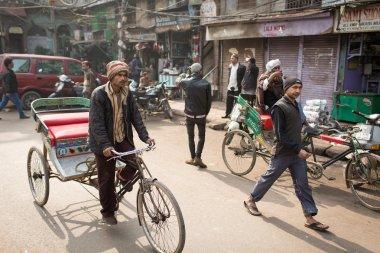 DELHI, INDIA - JAN 06: An unidentified rickshaw driver on the st