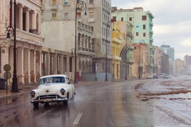 HAVANA - FEBRUARY 19: Classic car and antique buildings on Febru