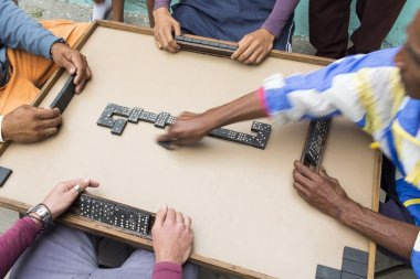 Cropped image of people playing domino on street