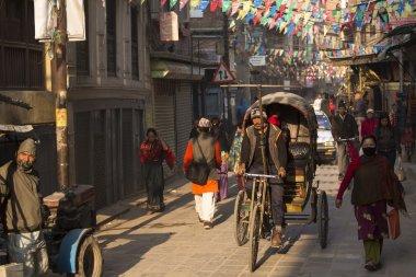 THAMEL, KATHMANDU, NEPAL - NOVEMBER 20, 2014: Rickshaws driving