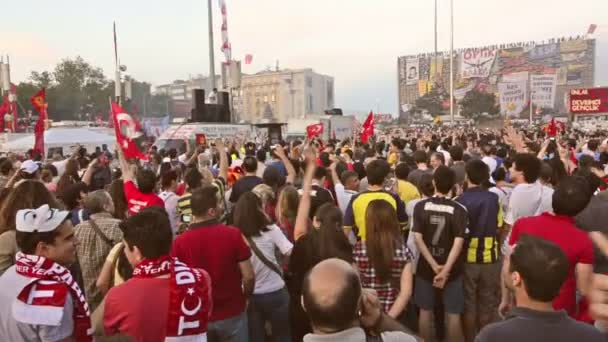 ISTANBUL, TURKEY- CIRCA JUNE 2013: Protesters singing songs in Taksim Square.
