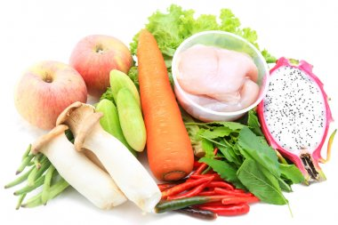 Photo of a table top full of fresh vegetables such as carrot mus