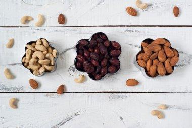 Almonds, cashews,  and briar in a cookie cutters.