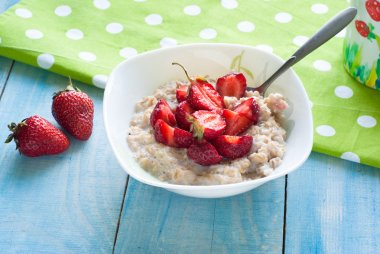 Milk oatmeal porridge with strawberries