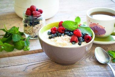 Healthy breakfast - oatmeal with berries