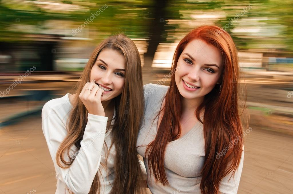 Two sexy, beautiful young happy women