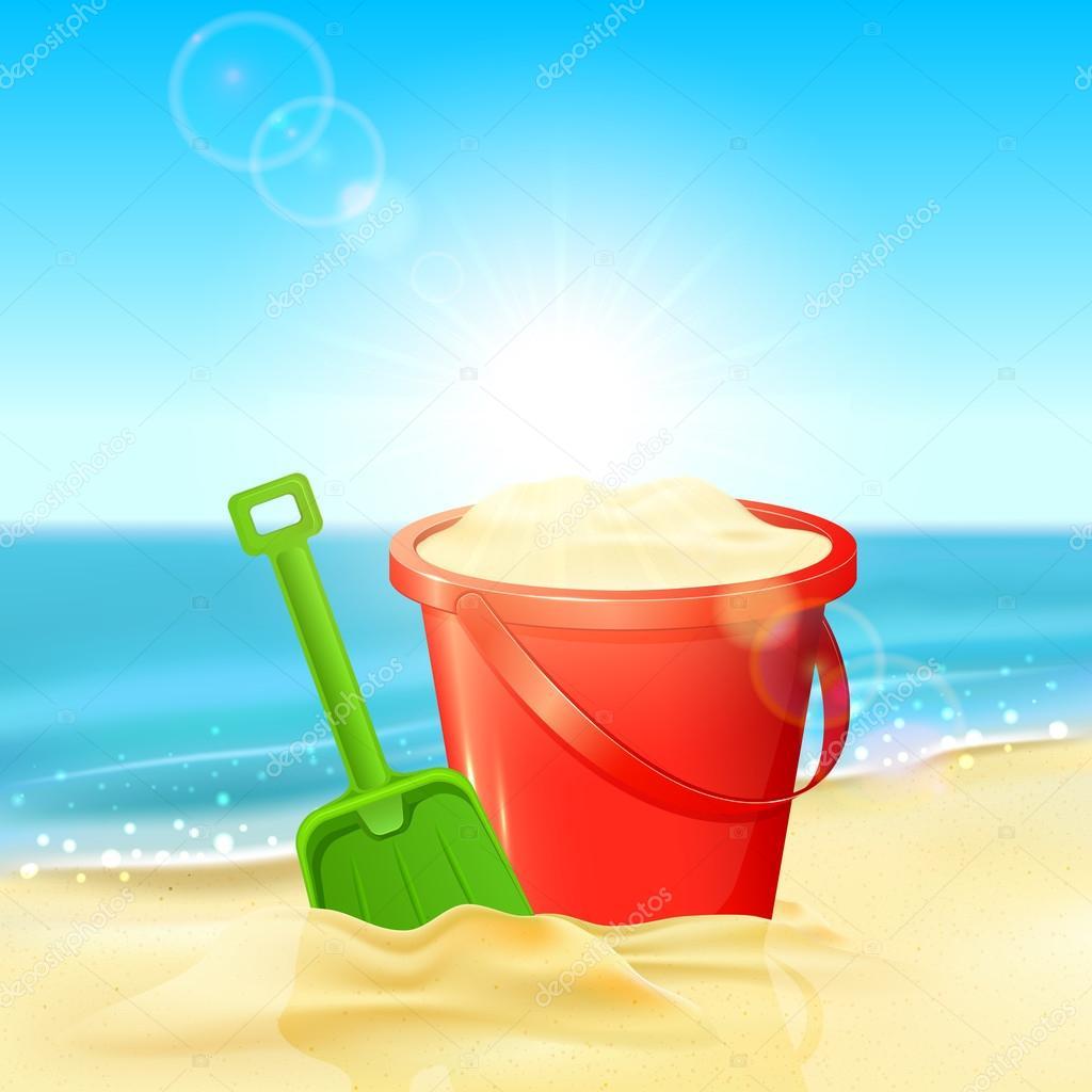 Balde de arena y una pala en la playa archivo im genes for Arena de playa precio
