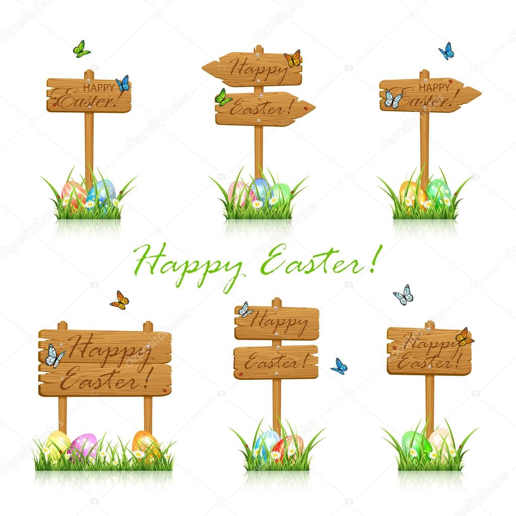 Set of wooden Easter signs in grass