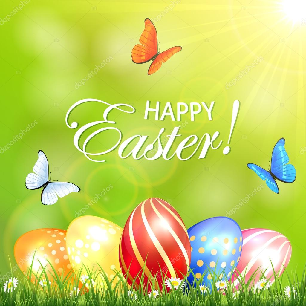 Sunny background with Easter eggs in a grass and butterflies