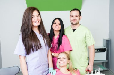 Dentist team and smiling patient