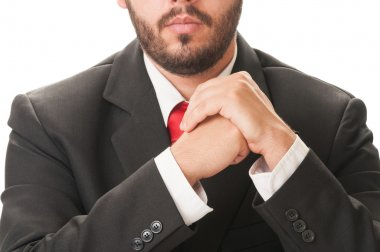 Business man with beard, black suit and red tie