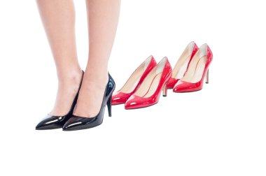 Black business woman shoes versus high heel red