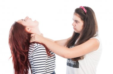 Bullying girl strangling her friend