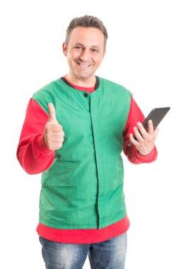 Friendly supermarket employee using wireless tablet