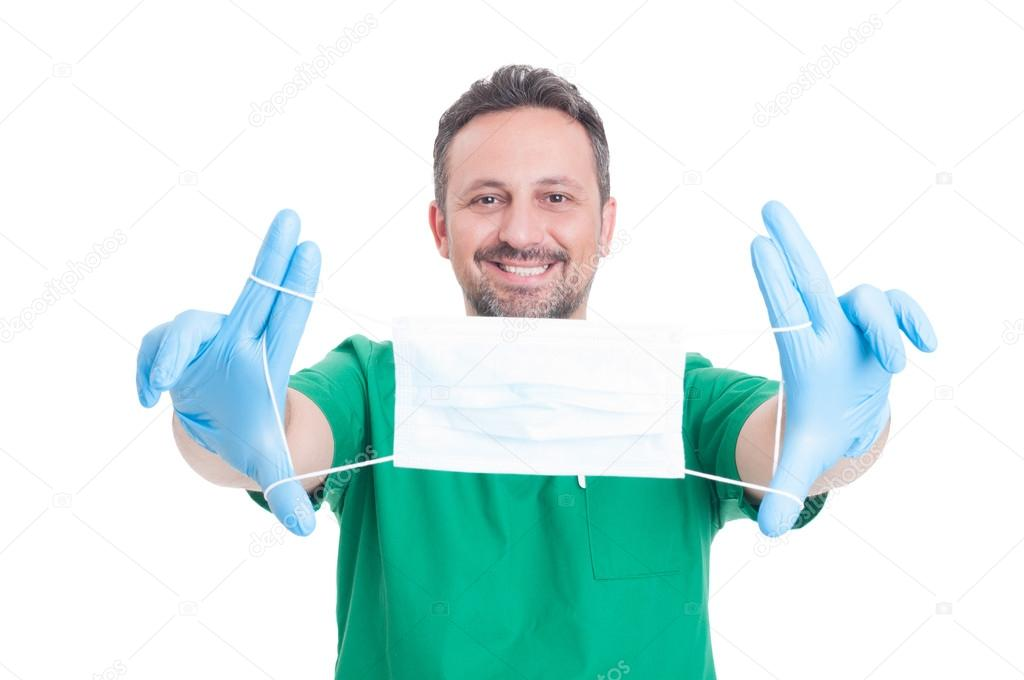 Doctor holding surgical mask with text area