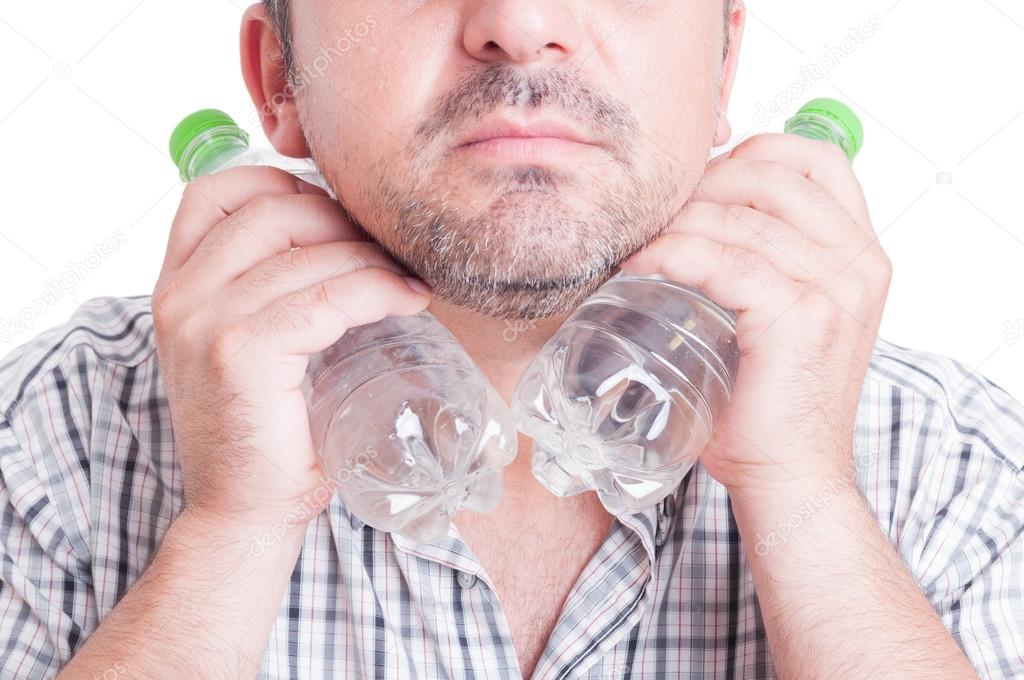 Man cooling his neck using cold water plastic bottles
