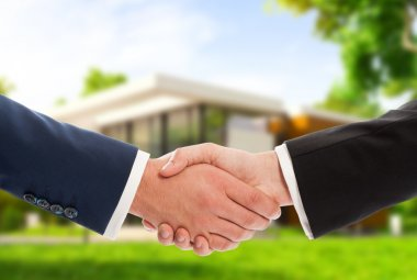 Handshake on house outdoor background