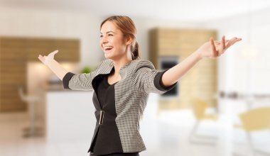 Excited real estate agent or broker with arms wide open