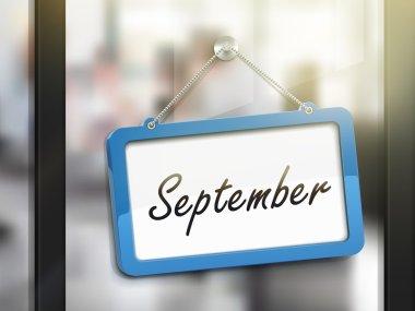 September hanging sign