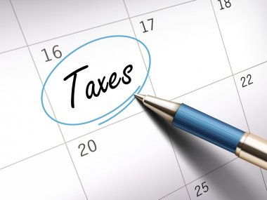 taxes word marked