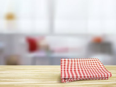 closeup of wooden desk and tablecloth in room