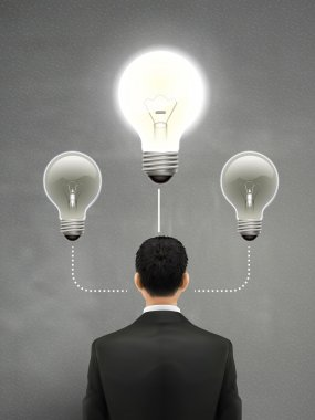 businessman with lighting bulb above head