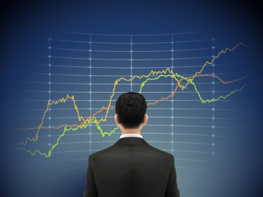 businessman stands in front of forex chart