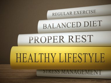 Stack of books with healthy lifestyle concept