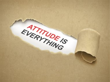 Paper torn to reveal phrase attitude is everything