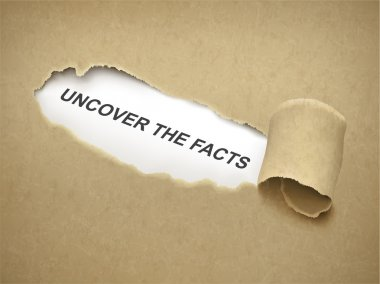 Paper torn to reveal phrase uncover the facts