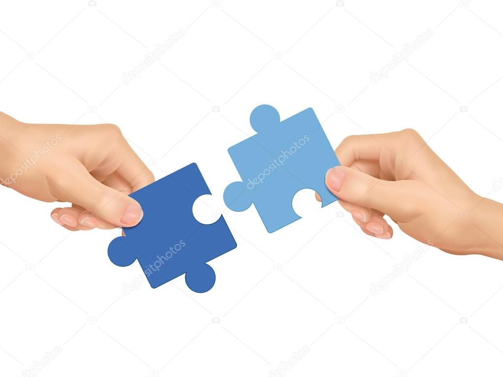 cooperation concept: hands holding jigsaw pieces