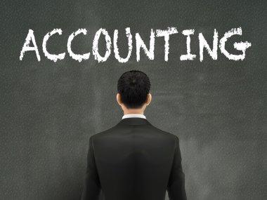 businessman looking at accounting word