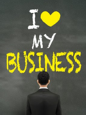 businessman looking at I love my business words