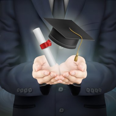 businessman holding graduation caps and diploma