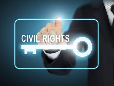 male hand pressing civil rights key button