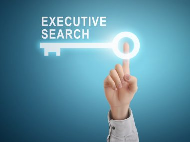 male hand pressing executive search key button