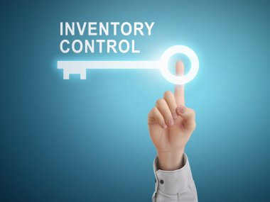 male hand pressing inventory control key button